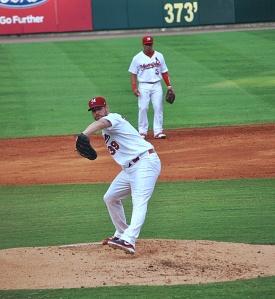 Chris Carpenter pitches Saturday at AutoZone Park in Memphis Saturday. Redbirds second basebman Kolten Wong readies himself.  -- Miranda Remaklus
